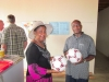 christine-accepting-gift-of-soccer-balls
